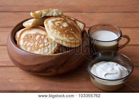 Fried Fritters On Plate With Sour Cream And Milk