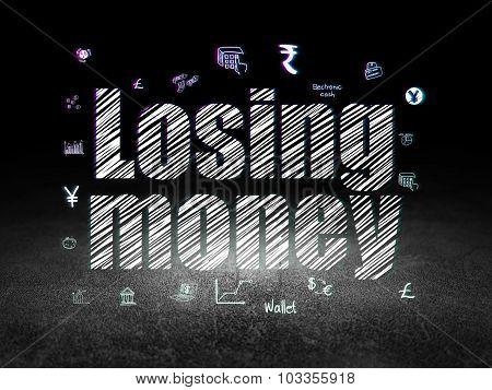 Money concept: Losing Money in grunge dark room