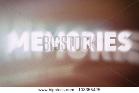 Memories Word On Vintage Blurred Background