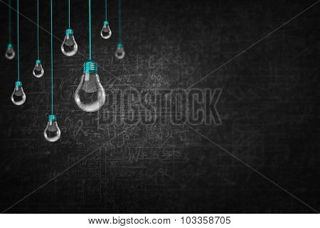 Conceptual image with light bulbs hanging from above