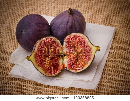 Three Ripe Figs On Baking Paper Background
