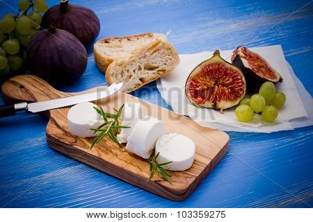 Goat Cheese With Ripe Figs And Grapes