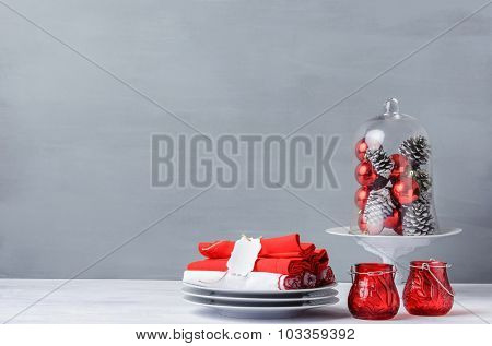 Modern christmas decoration table display in simple, elegant, minimalist style with lots of copy space, glass dome or cloche for xmas ornaments