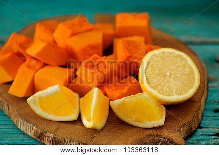 Sweet Pumpkin, Orange And Lemon Cut On Wooden Board