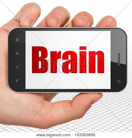 Healthcare concept: Hand Holding Smartphone with Brain on display