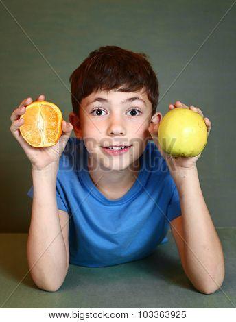 Boy Hold Orange And Apple Close Up Portrait
