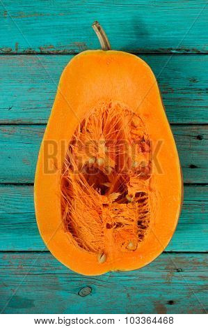 Half Of Butternut Squash On Wooden Turquoise Table