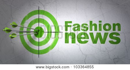 News concept: target and Fashion News on wall background