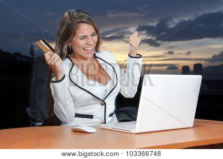 Happy Woman Shopping Online Using Her Credit Card On The Web
