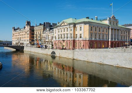 Exterior of the historical buildings at the riverside in Stockholm, Sweden.