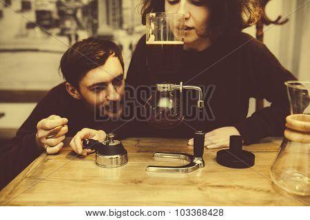 Vintage couple preparing coffee