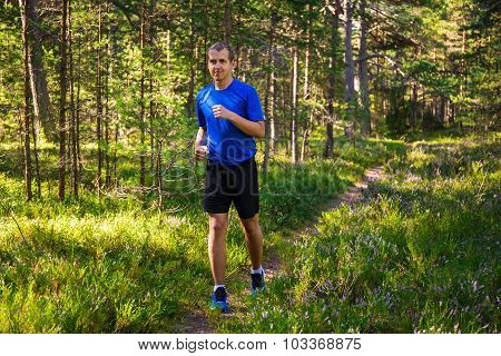 Sport Concept - Man Jogging In Forest