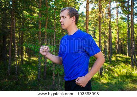 Jogging - Handsome Man Running In Forest