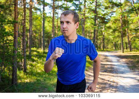 Jogging - Handsome Man Running In Summer Forest