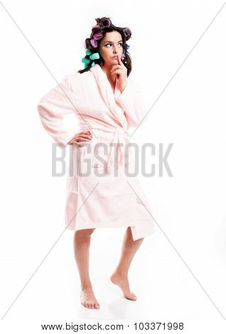 Thinking Woman In Bathrobe And Hair With Curlers