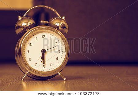 Alarm clock on the floor
