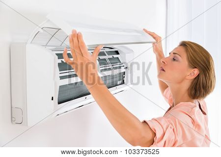 Woman Opening Air Conditioner