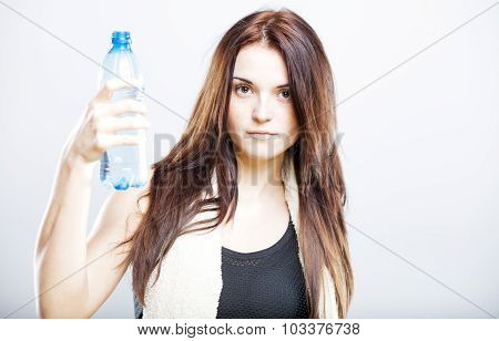 Woman After Fitness Class Proposing A Bottle Of Water