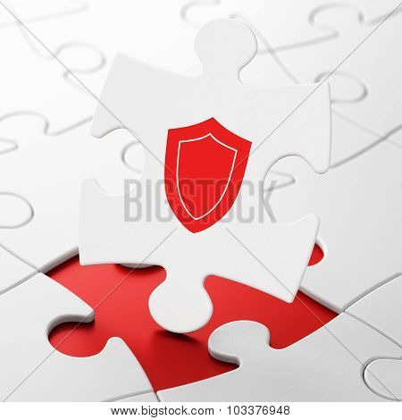 Privacy concept: Shield on puzzle background
