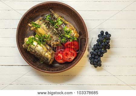 Smoked Fish With Vegetables In Takrelke With Grapes