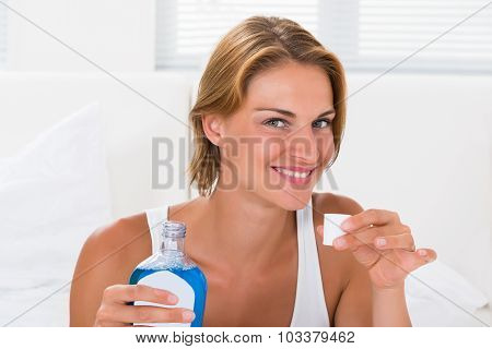 Woman Holding Bottle Of Mouthwash