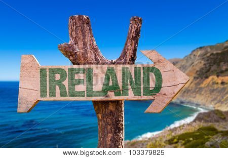 Ireland wooden sign with coast background
