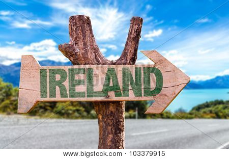 Ireland wooden sign with road background