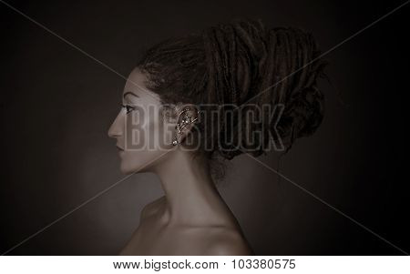 Nefertiti, Stylized Fashion Shoot. Woman With A Dreadlocks Bun Hairstyle