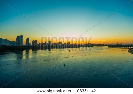 View on the Drepr Dnieper river and cityscape at evening in Kiev, Ukraine