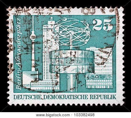GDR - CIRCA 1973: a stamp printed in GDR shows World Clock, Alexander Square, Berlin, circa 1973