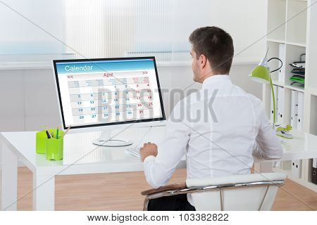 Businessman Looking At Calendar On Computer