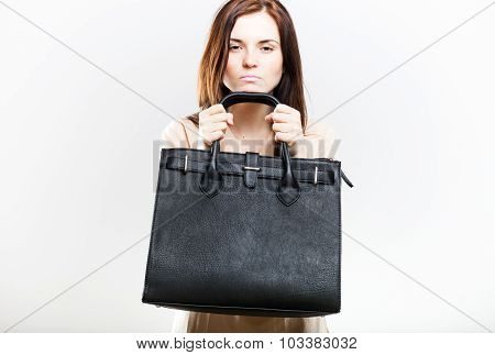 Angry Young Woman With Black Bag