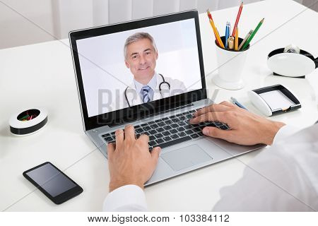 Businessperson Videochatting With Doctor On Laptop