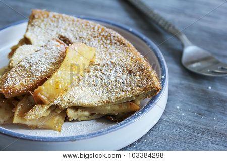 Apple Popover Baked desert in a skillet