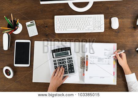 Businessperson Calculating Tax