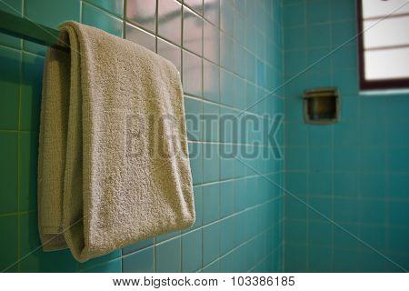 Towel on Rack in Blue Tile Vintage Bathroom