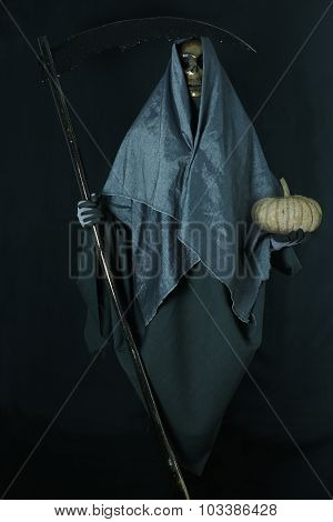 Halloween concept and background, Messenger of death with pumpkin in Halloween