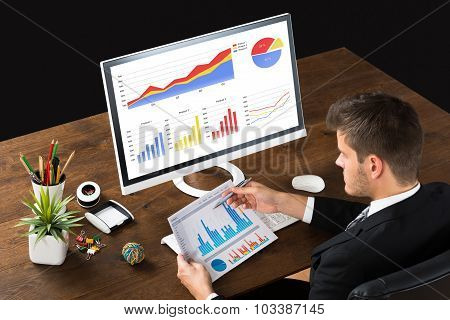 Businessman Analyzing Statistic Report