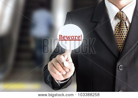 Businessman hand pointing on the screen keypad careful - can be used for editing text or image of yo