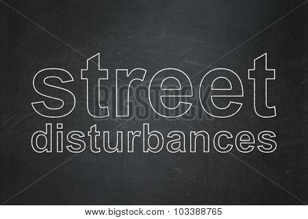 Political concept: Street Disturbances on chalkboard background