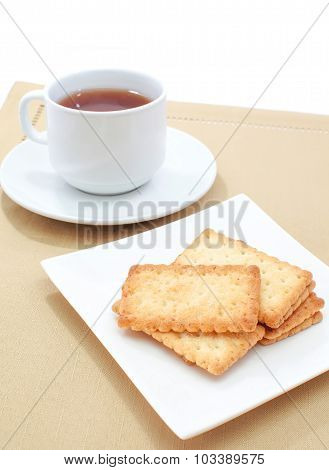 Coconut biscuit and a cup of hot tea