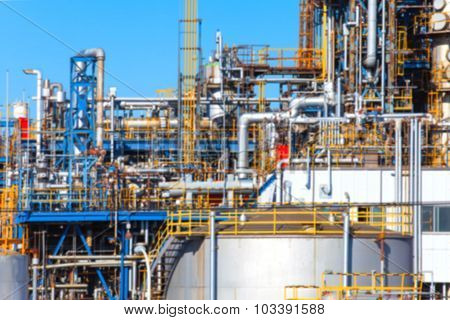 Blurred background of Industrial view at oil refinery plant form industry zone