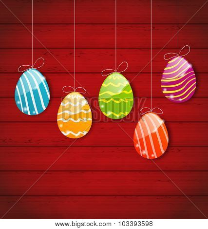 Easter three ornamental colorful eggs on wooden background
