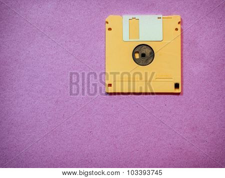 Vintage yellow floppy disk