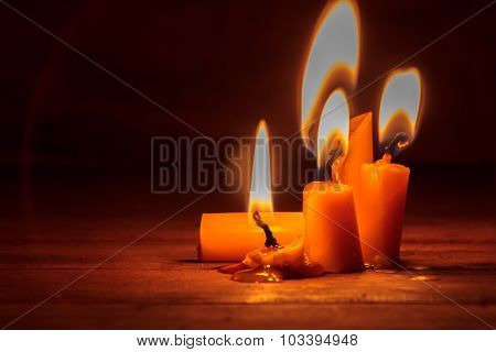 Selective Focus Candle On Wood Background.