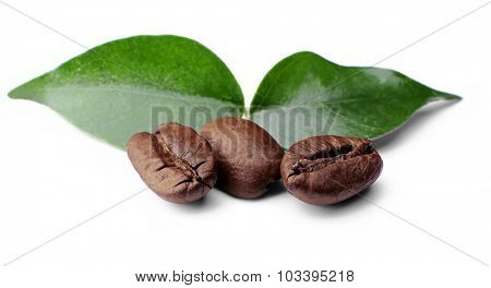 Coffee beans with leaves isolated on white