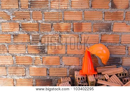 Construction Helmet Safety And Cone In Construction Site With Bricks