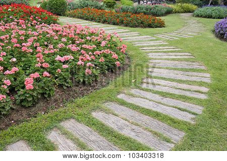 Landscape Of Floral Gardening With Pathway In Garden