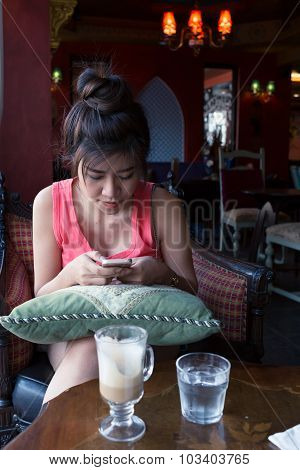 Women Lifestyle Used A Mobile Phone In Cafe Coffee Shop With Texting Message