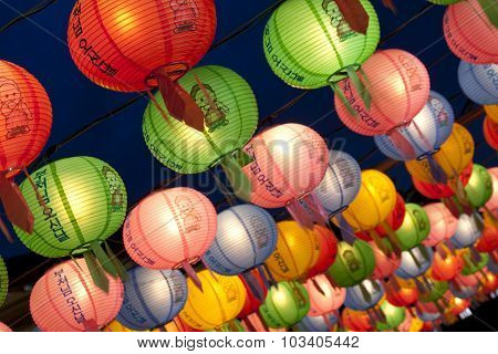 Hanging lanterns for celebrating Buddhas birthday. The text on lantern means Buddhas birthday